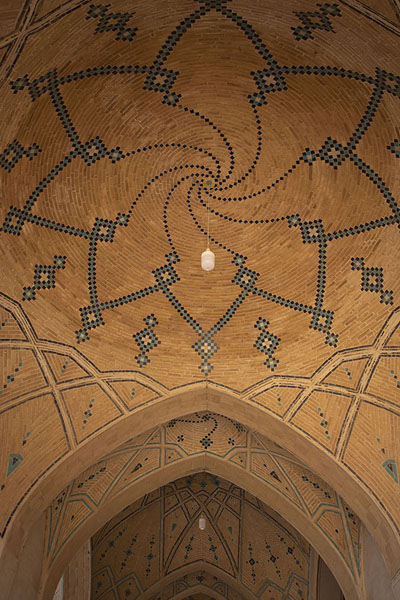 Looking up the decorated cupola inside the main building | Masjed-e Agha Bozorg | Iran