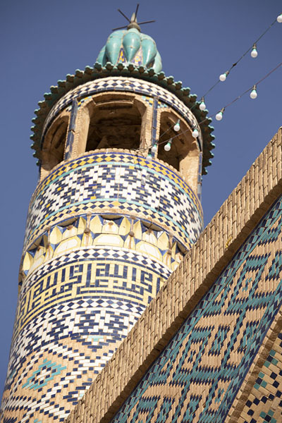 Foto van One of the richly decorated minarets of the mosqueKashan - Iran
