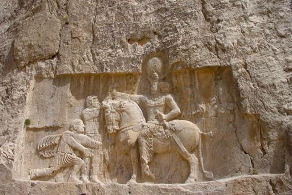Foto van One of the reliefs hewn out in the cliffs under the tombsPersepolis - Iran
