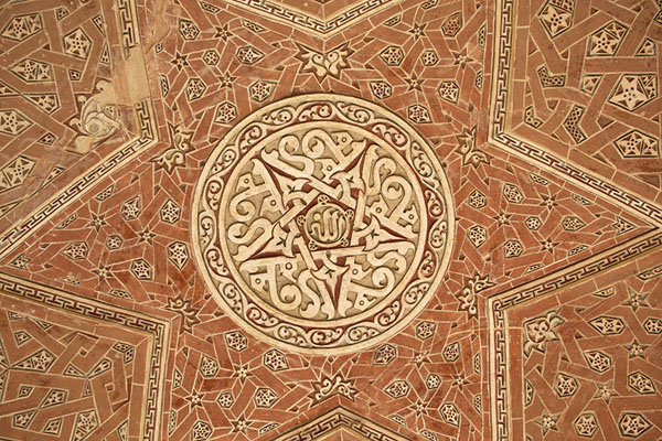 Looking up the finely carved decorated ceiling of one of the terraces of the mausoleum | Oljeitu Mausoleum | 伊朗
