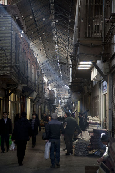 Picture of People walking through the bazar with light filtering through the ceiling