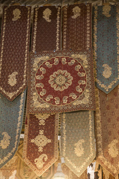 Small carpets hanging for sale at the bazar | Teheran Bazaar | Iran