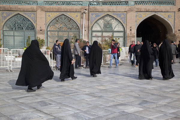Picture of Veiled women walking towards one of the main mosques inside the bazar