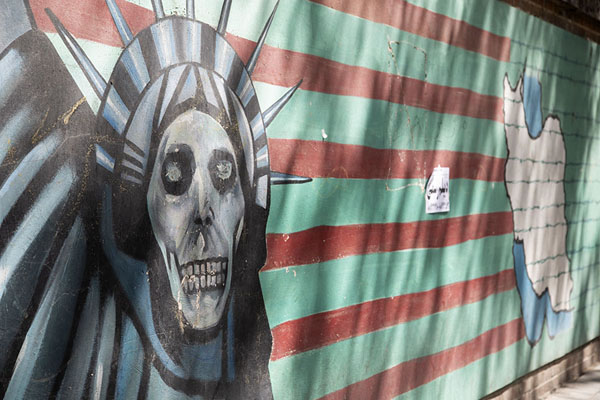 Wall painting outside the former US embassy with statue of liberty with skull | US Den of Espionage | Iran