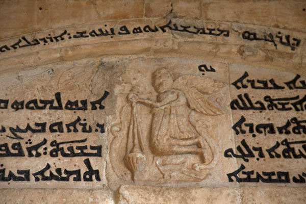 Foto van Detail of a figure with Aramaic writing on the wall of the monasteryAl Qosh - Irak