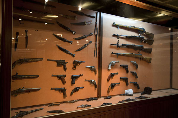Some of the weapons on display in a building of the prison complex | Amna Suraka prison | Iraq