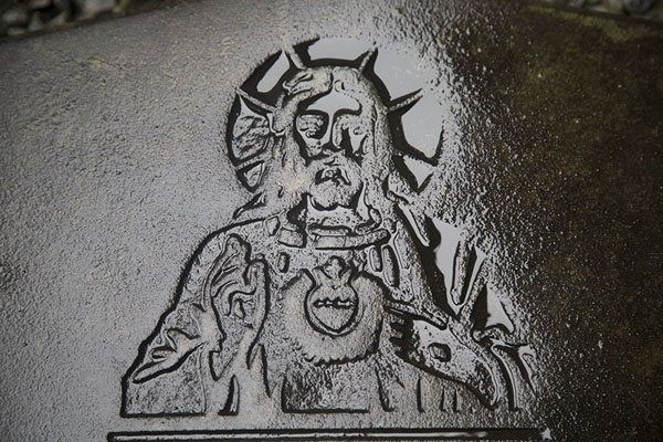 Picture of Corcomroe Abbey (Ireland): Jezus carved in a tombstone on the floor of Corcomroe Abbey