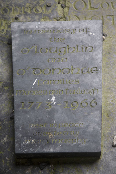 Picture of Corcomroe Abbey (Ireland): Family tombstone spanning two centuries in Corcomroe Abbey
