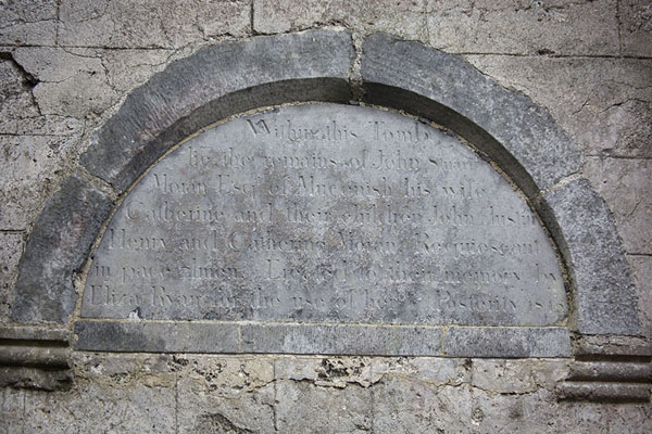 Picture of Corcomroe Abbey (Ireland): Inscription near an early 19th century family tomb at the abbey