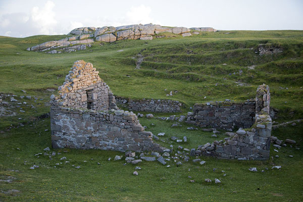Picture of Teampaill Feichin, medieval parish church, was excavated and now stands in the green fields of Omey Island