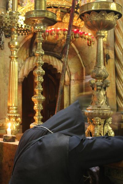In deep prayer at the Tomb of Christ | Santo Sepulcro | Israel