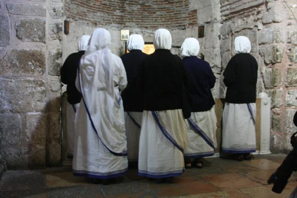 Nuns praying in an altar | Church of the Holy Sepulchre | Israel