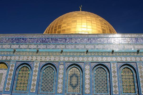 Picture of Blue and green exterior with golden Dome of the Rock