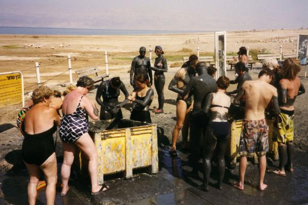 Applying black mud for a healthy skin | Israeli Dead Sea | Israel