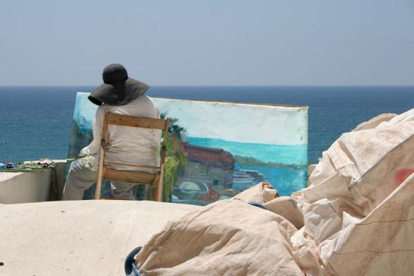 Painter being inspired by the sea off the Jaffa coast | Jaffa | Israel