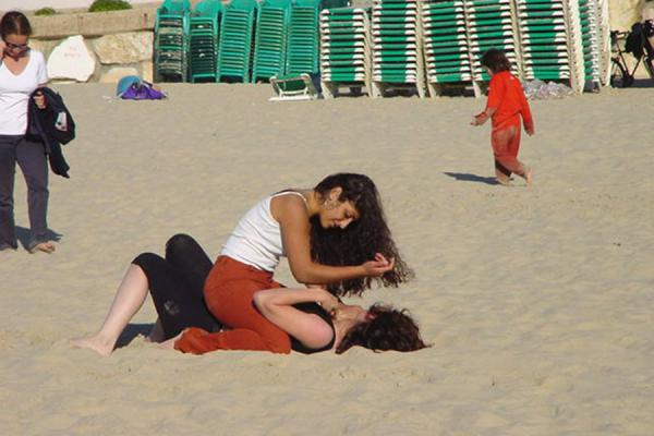 Picture of Tel Aviv Waterfront (Israel): Girls having fun on the beach of Tel Aviv