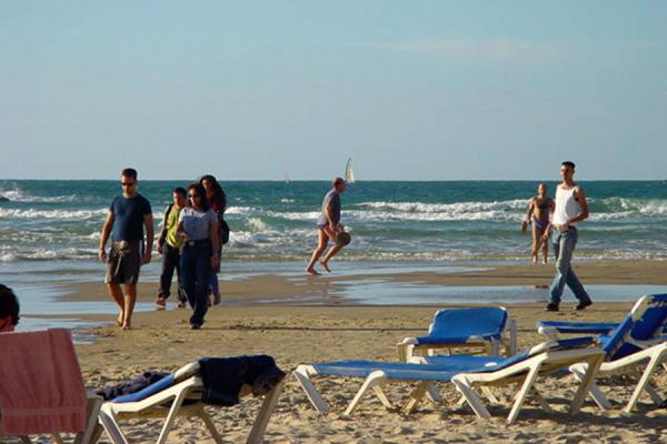 Go To Previous Picture Of Relaxing People On The Beach Tel Aviv
