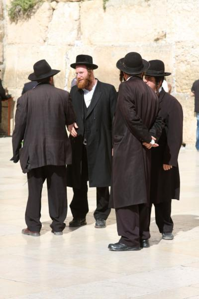 Picture of Western Wall (Israel): Men in black in a discussion at the Western Wall