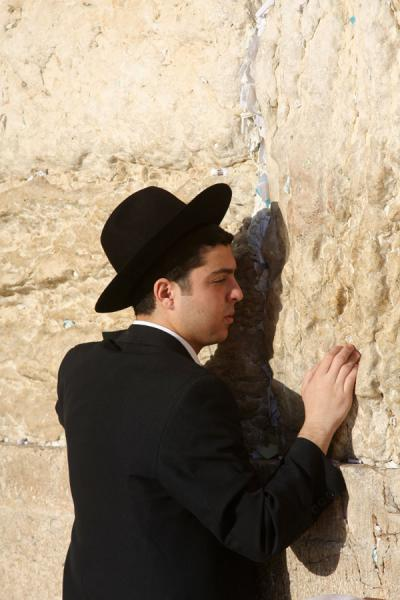 Picture of Western Wall (Israel): Suit and hat, in touch with the Western Wall