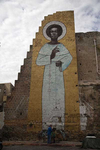 Picture of Giant mural on a ruin with two men in Albergheria - Italy - Europe