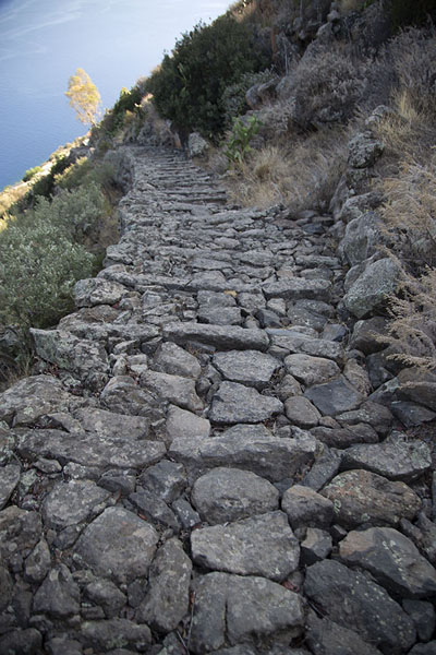 Stone trail leading up to the top of Alicudi island | Alicudi | Italy