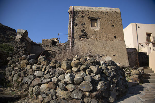 House with volcanic rocks towards the centre of Alicudi island | Alicudi | Italy