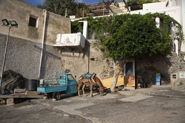 Small square in Alicudi village with mule and Api | Alicudi | Italy