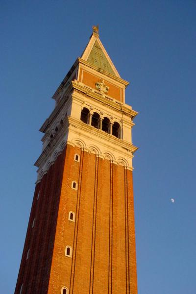 Bell tower rising up high, with the moon on the right | San Marco basilica | Italy