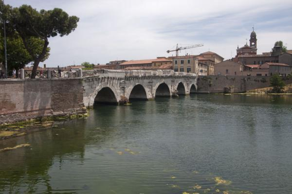 View of Rimini with the Bridge of Tiberius and the Marecchia in the foreground | Bridge of Tiberius | Italy