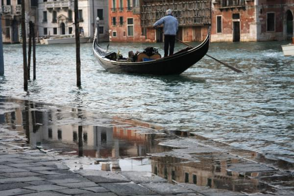 Gondola on an overflowing Canal Grande | Canal Grande | Italy