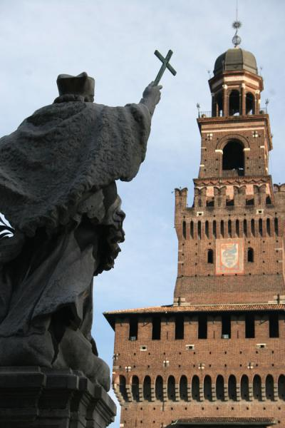 Saint raising his cross towards the Filarete, the central tower of Castello Sforzesco | Castello Sforzesco | Italy