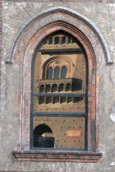 The castle reflected in one of the windows | Castello Sforzesco | Italy