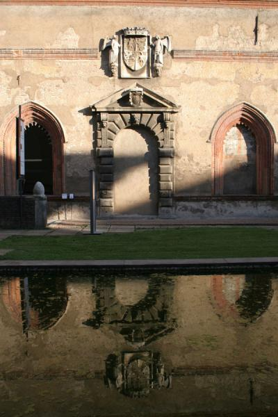 One of the walls of the castle reflected in a pond | Castello Sforzesco | Italy
