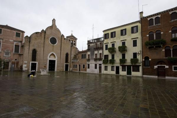 Small square and church in Castello | Castello | Italy