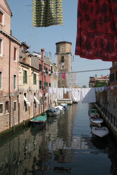 Laundry hanging over a canal in Castello | Castello | Italy
