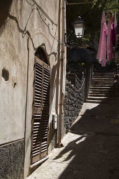 Alley in Cefalù with laundry and stairs | Cefalù | Italy