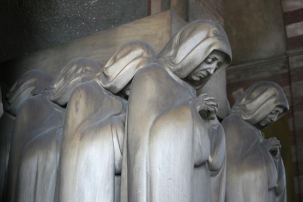 Mourning women at a tomb in the Cimitero Monumentale | Monumental Cemetery | Italy