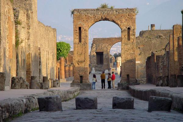 Arch in the streets of Pompei with stepping stones at the foreground | Pompei and Herculaneum | Italy