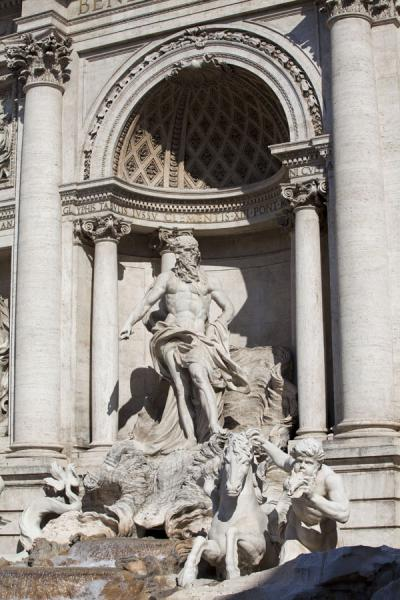 Oceanus with arch and Triton with winged sea-horse seen from one side | Trevi fountain | Italy