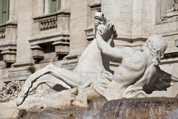 Triton with hippocamp, a winged sea-horse, at the foot of the Trevi fountain | Trevi fountain | Italy