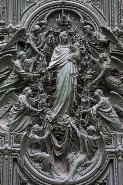 Close-up of one of the main doors with sculpture | Milan Cathedral | Italy