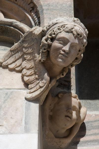 Picture of Milan Cathedral (Italy): Head of angel sticking out of the wall of the cathedral of Milan