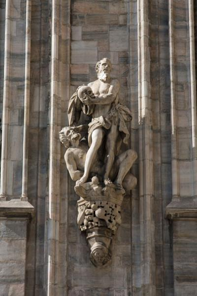 Picture of Milan Cathedral (Italy): One of the many sculptures on the outer wall of the cathedral