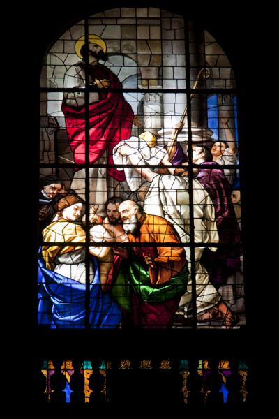 Stained glass window with religious scene seen from inside the cathedral | Milan Cathedral | Italy