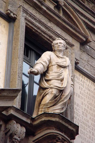 Scultpure seemingly standing out of a window | Milano Sculptures | Italy
