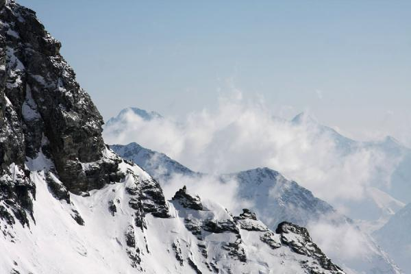 Picture of Monte Rosa skiing (Italy): View of mountains enveloped in clouds near Passo Salati