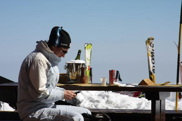 Picture of Monte Rosa skiing (Italy): Ski break: enjoying the sun, wine, food while making a phone call
