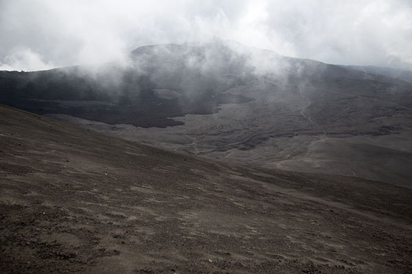 Clouds hanging over the barren landscape of the south side of Mount Etna | Mount Etna summit hike | l'Italie