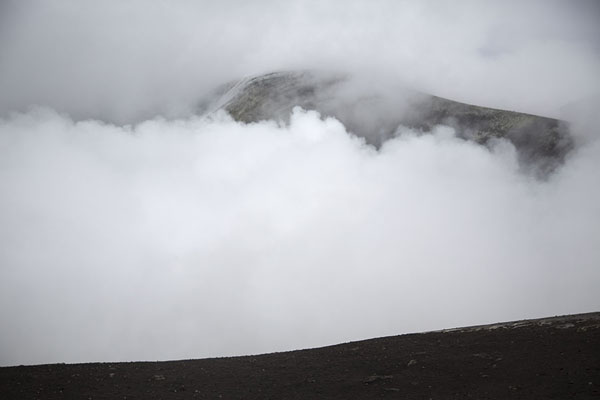 View of the Bocca Nuova, with the opposite side barely visible behind the clouds | Mount Etna summit hike | Italy