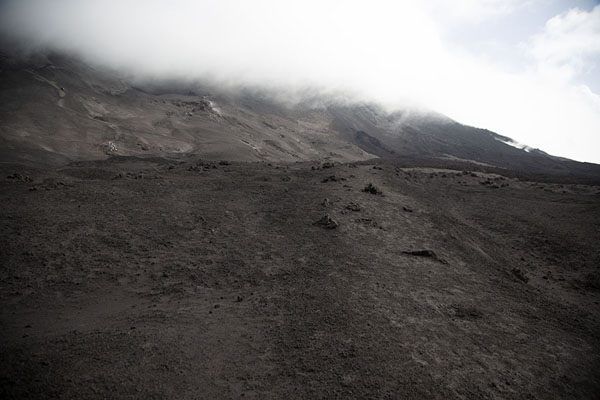 The south side of Mount Etna with steam and gases coming out of the ground | Mount Etna summit hike | Italy
